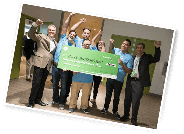 Method team celebrating after winning app development contest with their nonprofit CRM