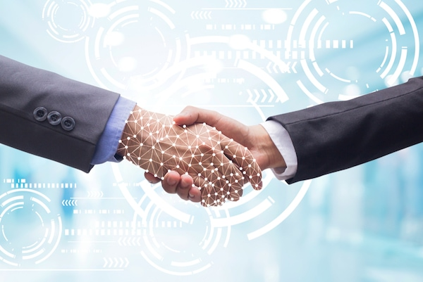 Close up of businessman hand shake with technology images in the background