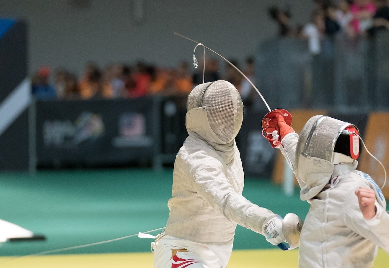 Two children fencing