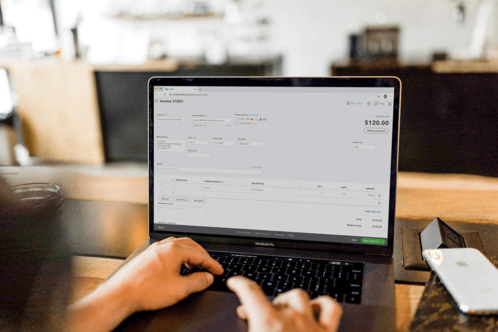 QuickBooks invoice screen on laptop