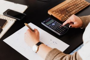An accountant using a calculator