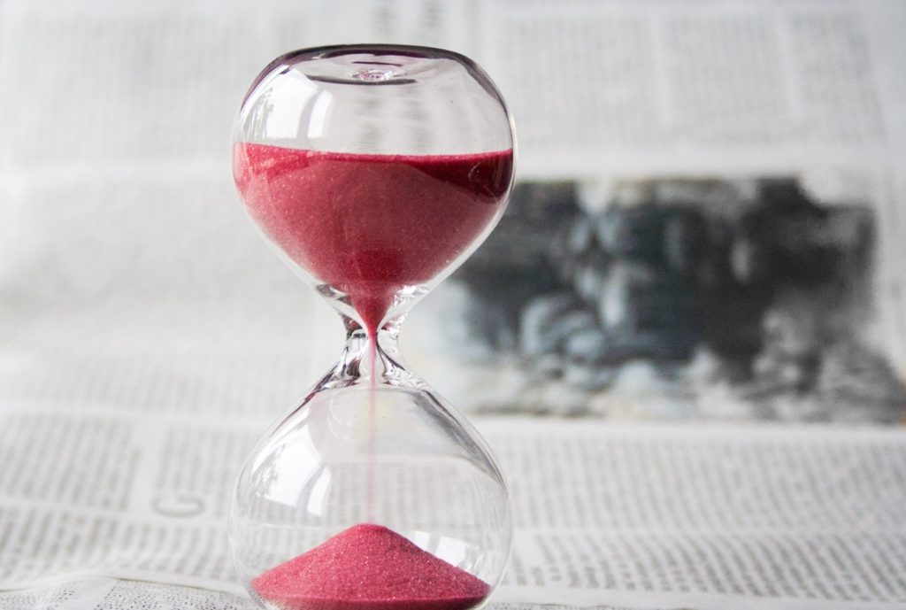 An hourglass represents the old ways that are being replaced by time tracking apps.